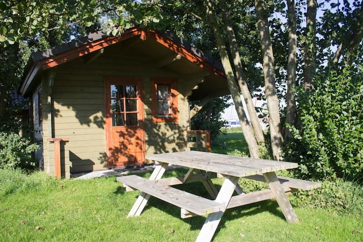"Cosy wooden cabin #1 at lake ""Veerse Meer"""