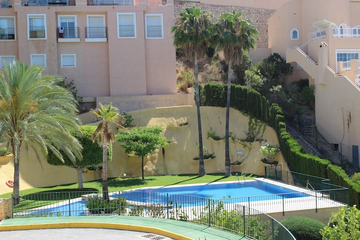 Swimming pool as seen from upstairs terrace