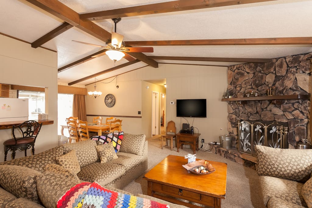 Great living area with Flatscreen TV with Cable. Rock woodburning fireplace.