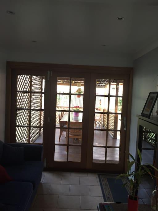 Bi-fold doors open to outdoor entertaining area.