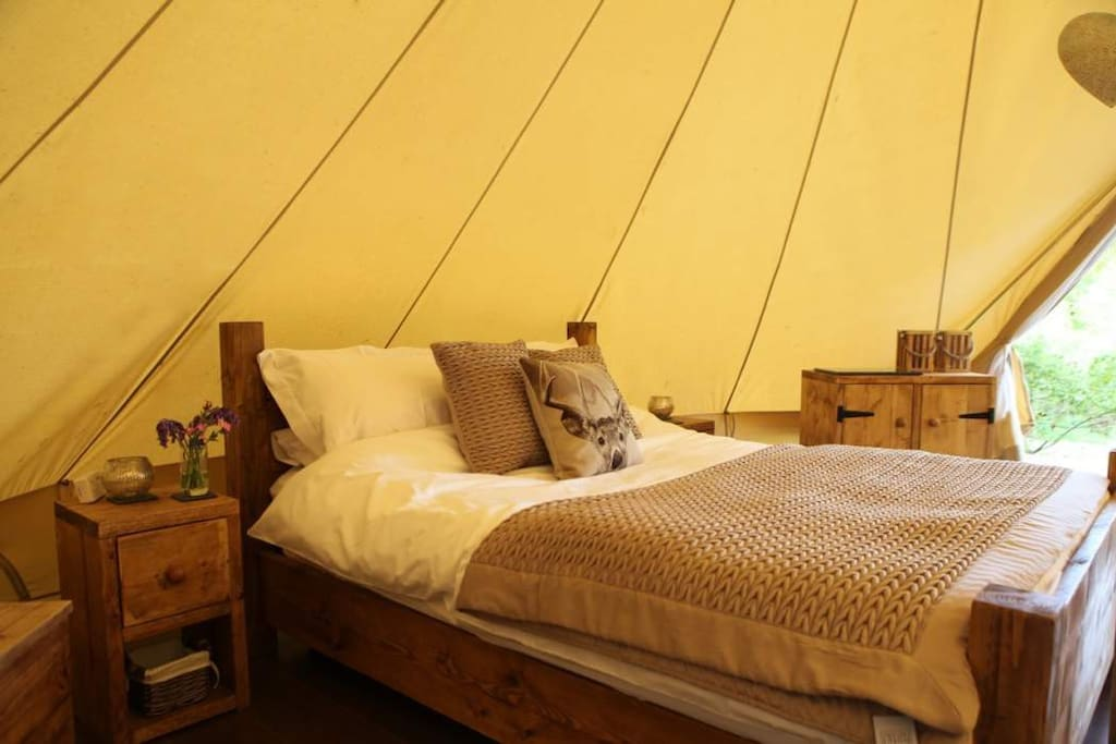 Our huge bell tents come with hardwood floors, real furniture, luxury linens and towels and a private ensuite bathroom