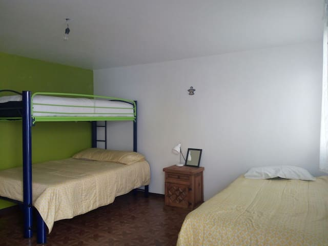 It is a spacious room, the wardrobe is big enough, the night table is rustic style, also charming.