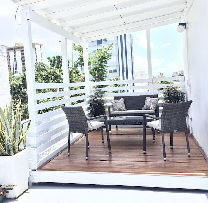 Sitting area in the covered part of the rooftop terrace