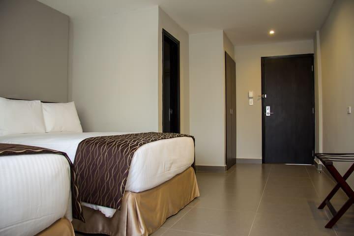 Habitación OjosdelRio 2 camas full