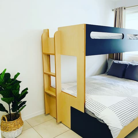 Second bedroom- perfect for kids or another couple. Has a double bed with a single bunk, also has a double built in wardrobe.