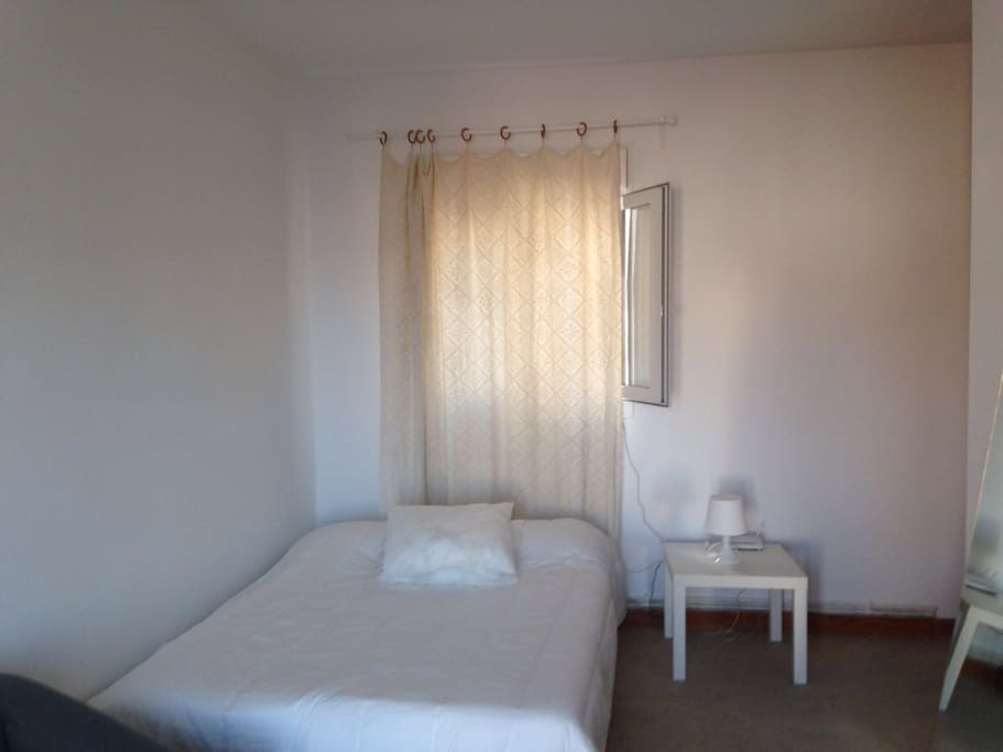 Very bright huge bedroom with balcony. King double bed, massive wardrobe, sofa and desk