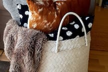 Cushions and luxurious throws to keep you warm and comfortable outside