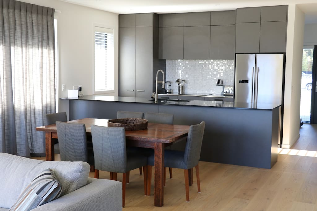 Kitchen/Dining with great in/outdoor flow to courtyard with a Weber Family Q BBQ
