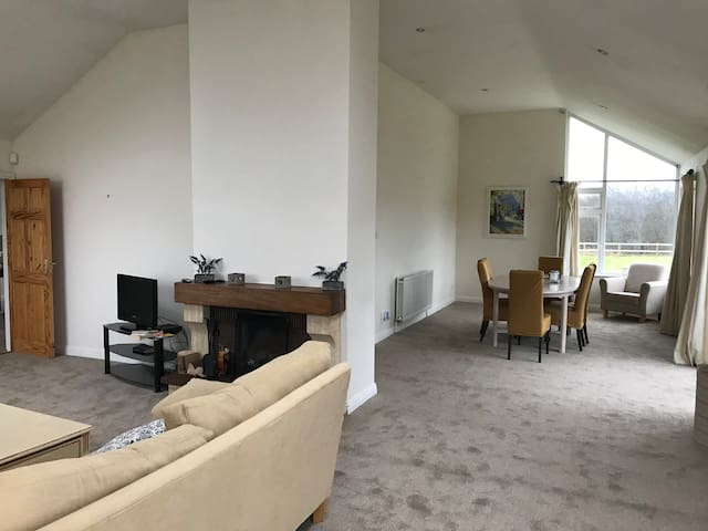 L shaped sitting & dining room. Lots of space in both for relaxing and eating