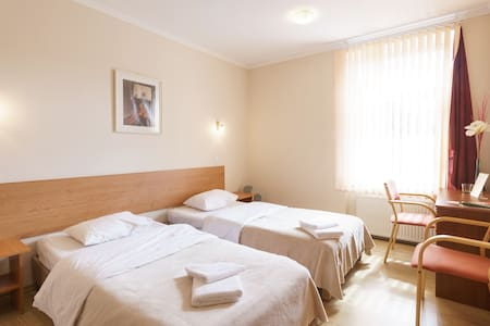 Twin room in a Guest House with shared kitchen - Рига