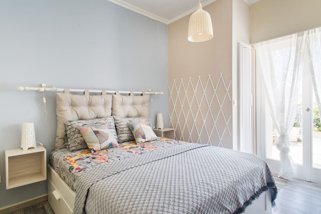 The bedroom with the queen size bed and tufted headboard!  4 large drawers give you an extra storage space under the bed!