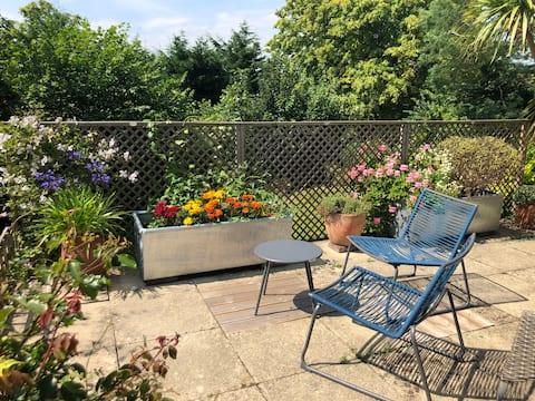 Stanton - garden apartment with sunny terrace.