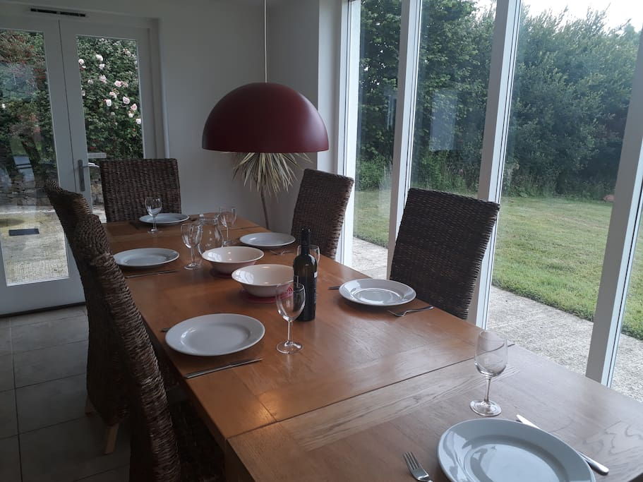Large oak dining table with views on to open countryside.