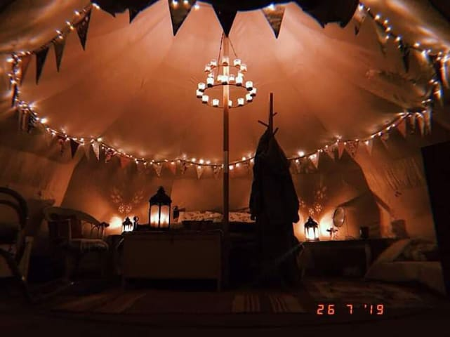 Lotus belle at night with lanterns, tea light chandelier and fairy lights