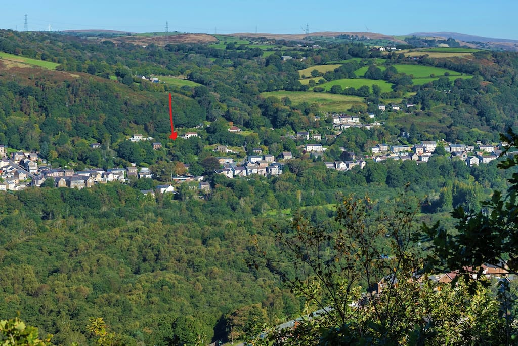 Our village - Ynysmeudwy (means land of the hermit watermeadow). The cottage is located approx by the read arrow. There,s lots of woodland, river, canal walks near. The Brecon Beacons are in the background.