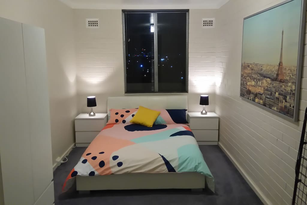 View of bed in bedroom at night