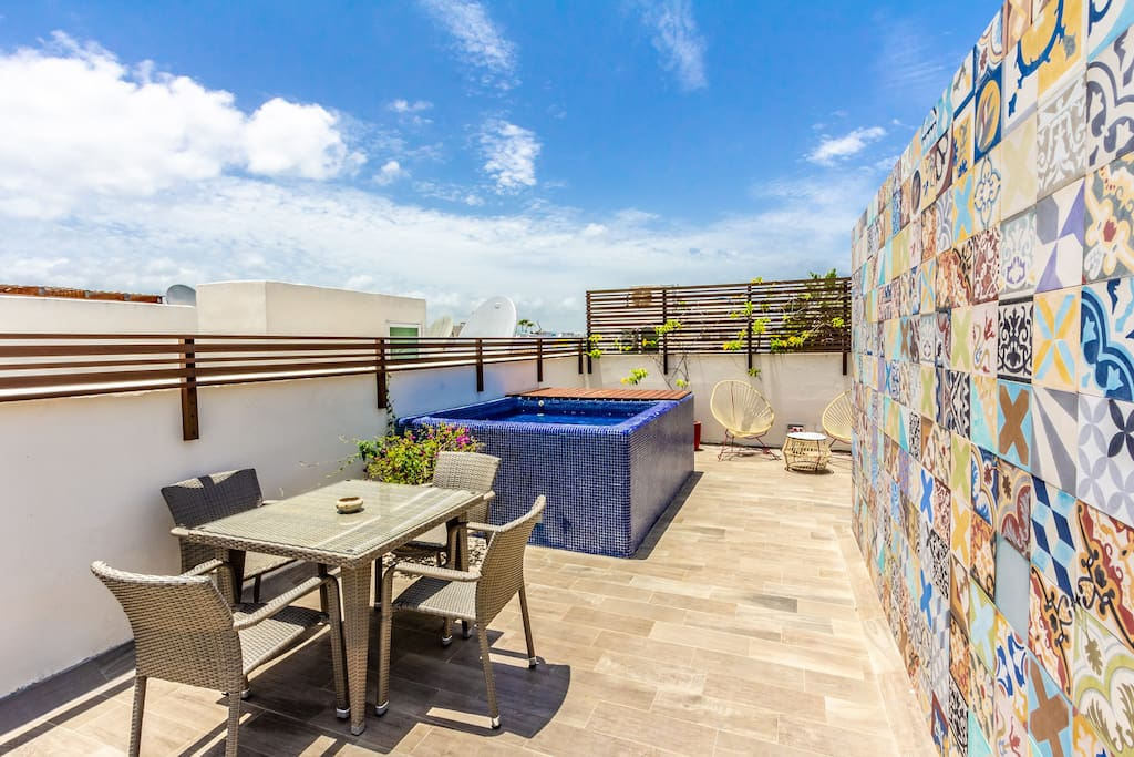 Your private patio offers plunge pool, dining area, loungers, BBQ and tropical plants.
