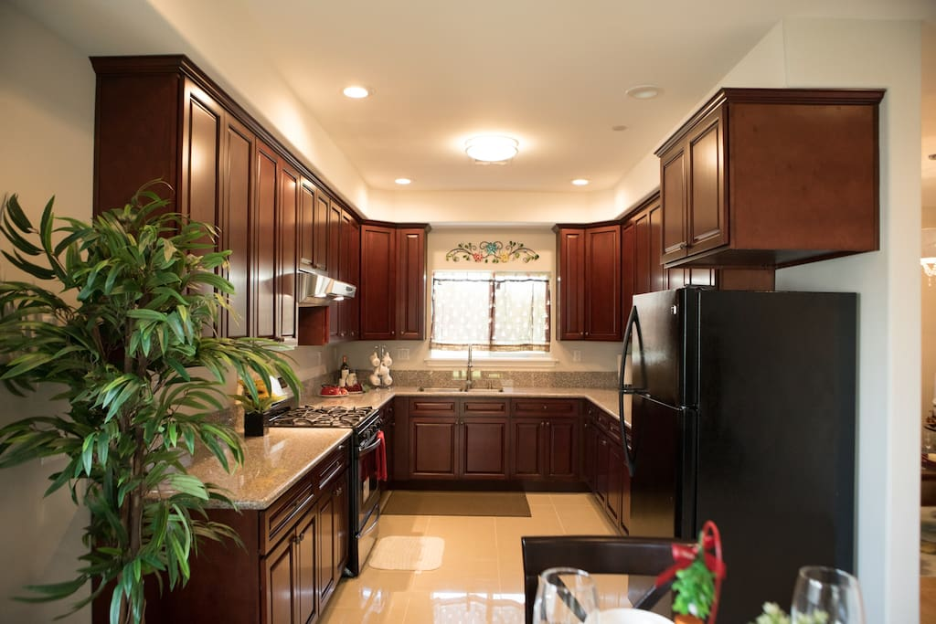 Full kitchen with large counter and open space for cooking.
