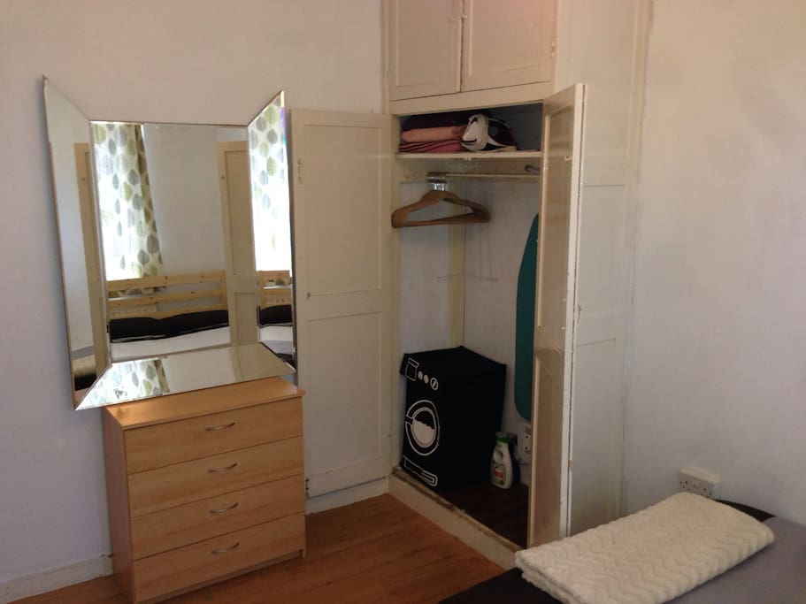 Loads of wardrope and chest of drawers space.