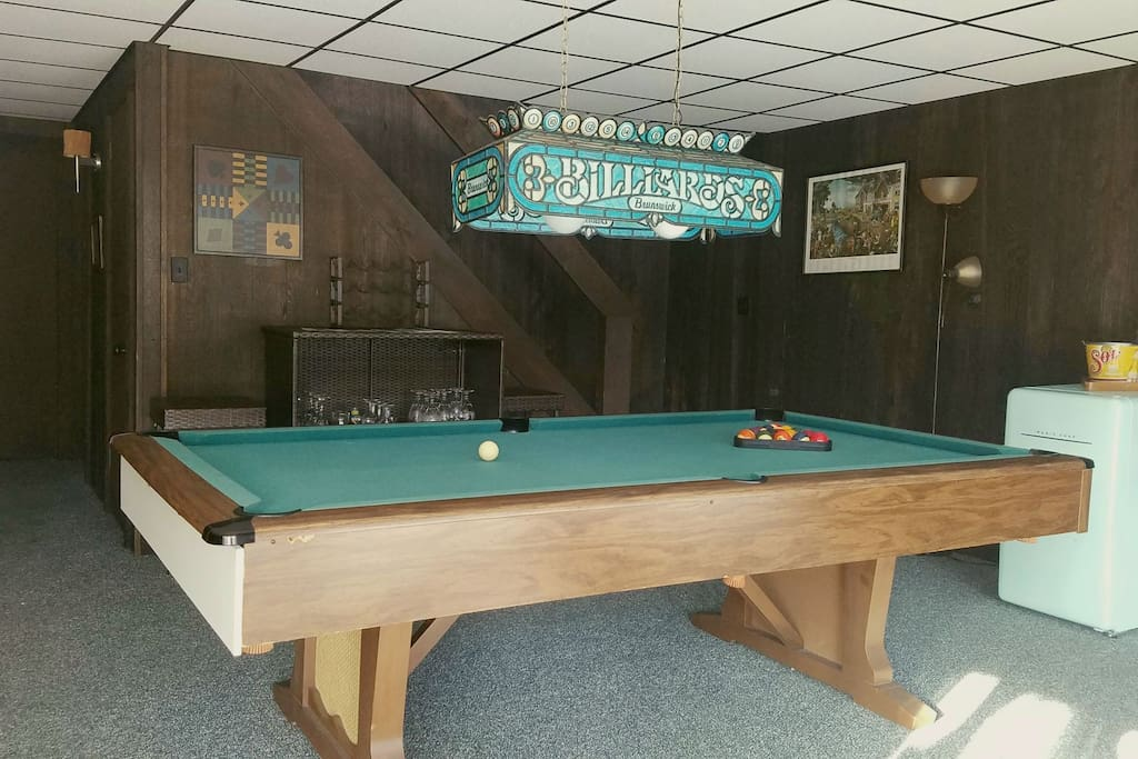 Pool table on first floor with mini fridge and board games!