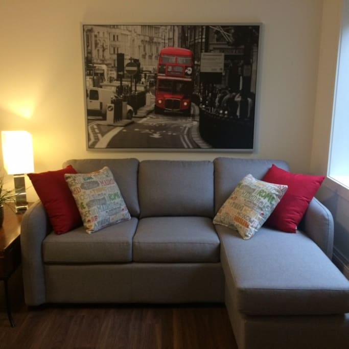 Living area is bright and comfortable; sofa has a comfortable, queen-size hideaway.