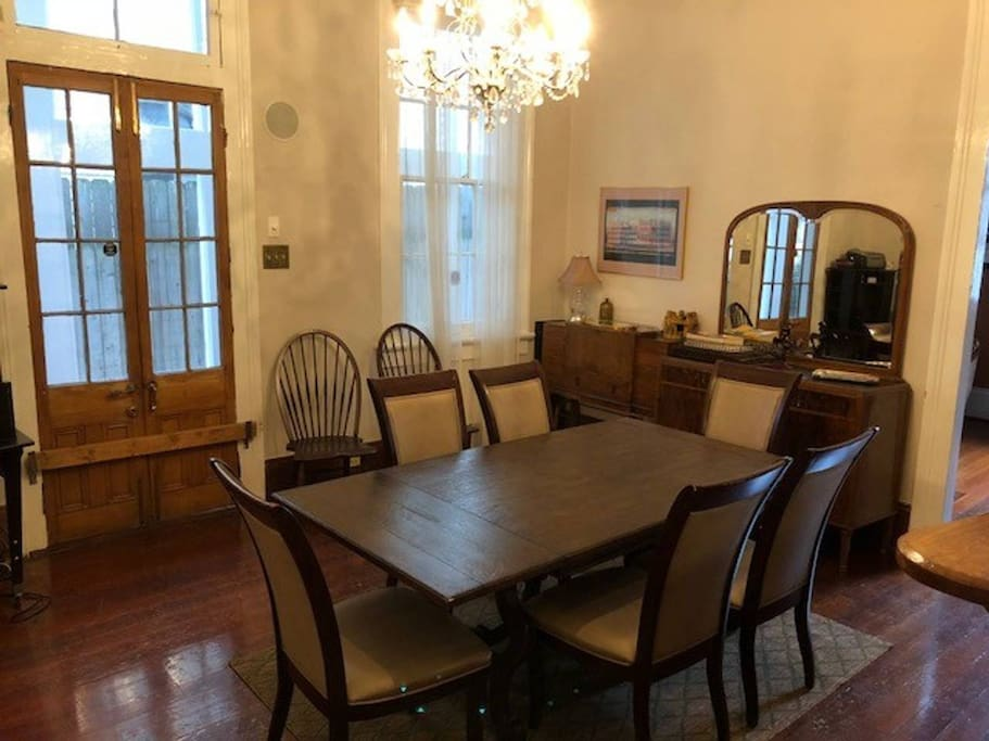 The former dining room now includes a beautiful Ethan Allen sofa, as well as a daybed to sleep an additional guest.