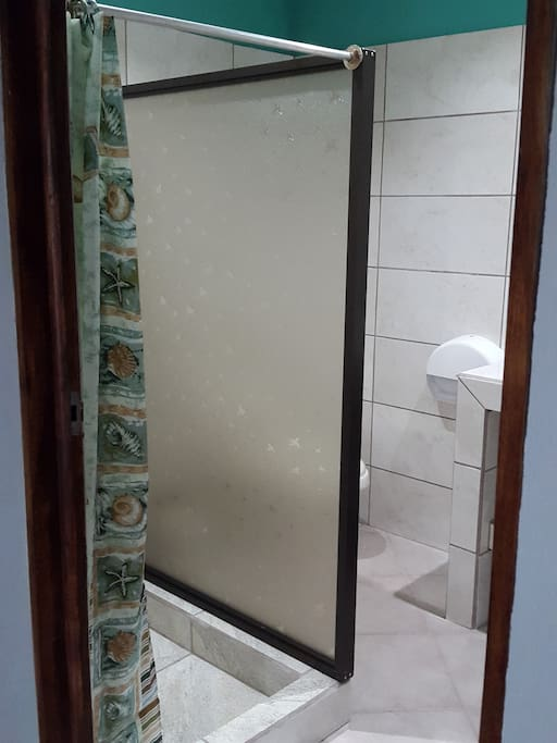 Private, clean bathroom with hot water shower