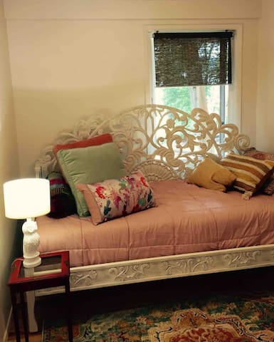 The single bedroom has an inviting day bed for reading or napping and is a cozy private room for sleeping at night