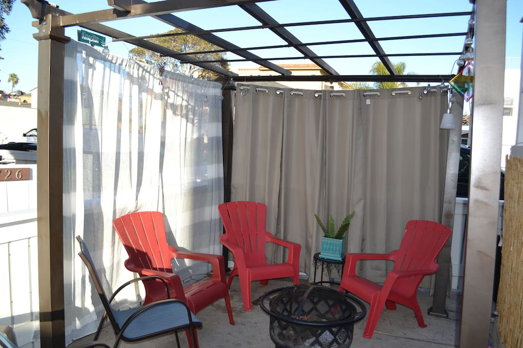 There is a shared court yard on the walk street. Enjoy the fire pit and BBQ with neighbors while waving to people walking to the beach!