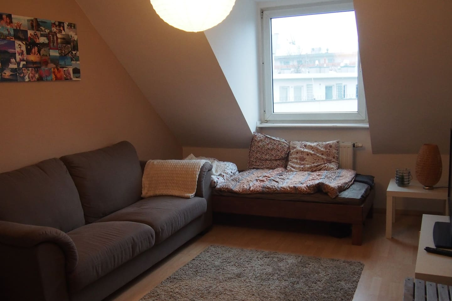 The Living Room, w/ one Single Bed and a comfortable couch + TV