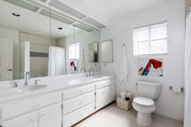 Large master bathroom with double sinks, new countertops and tile flooring
