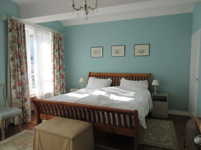 Main bedroom with king size bed and private shower room. Tea and coffee making facilities in the room.