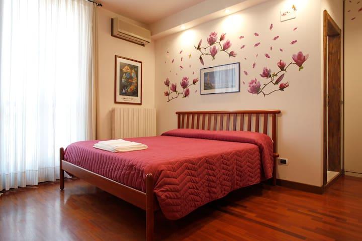 Camera delle Magnolie. Elegante quadrupla Deluxe