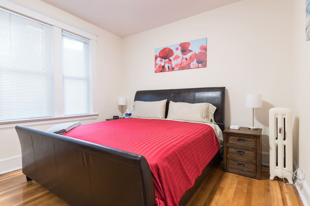 Master Suite-Angle 1: Features a King Sized bed and an adjoining room with a bunk bed that can accommodate an extra 2 guests!