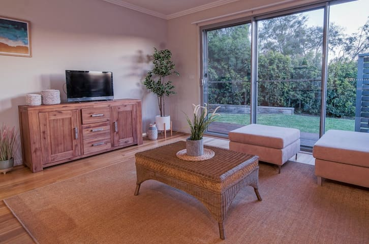 Relax in the family room while you watch the kids play with the dog in the backyard.