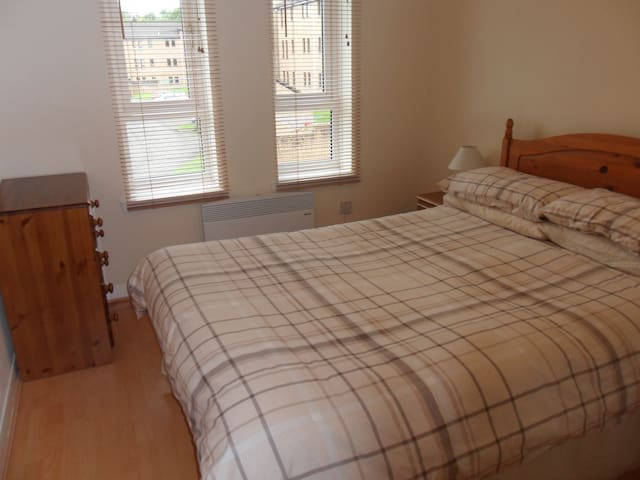Comfortable Bedroom with Double Bed and Storage.