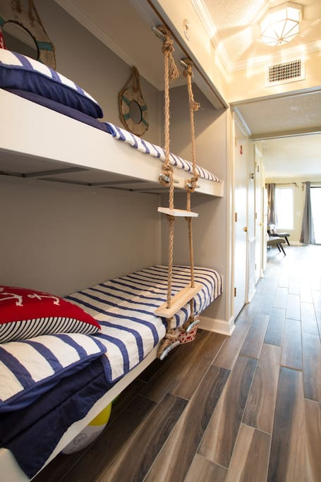 Nautical bunk beds with beachy rope ladder