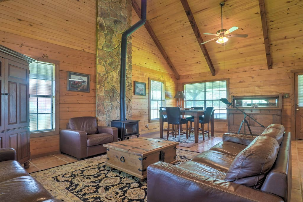 The interior features vaulted ceilings with exposed wood beams.