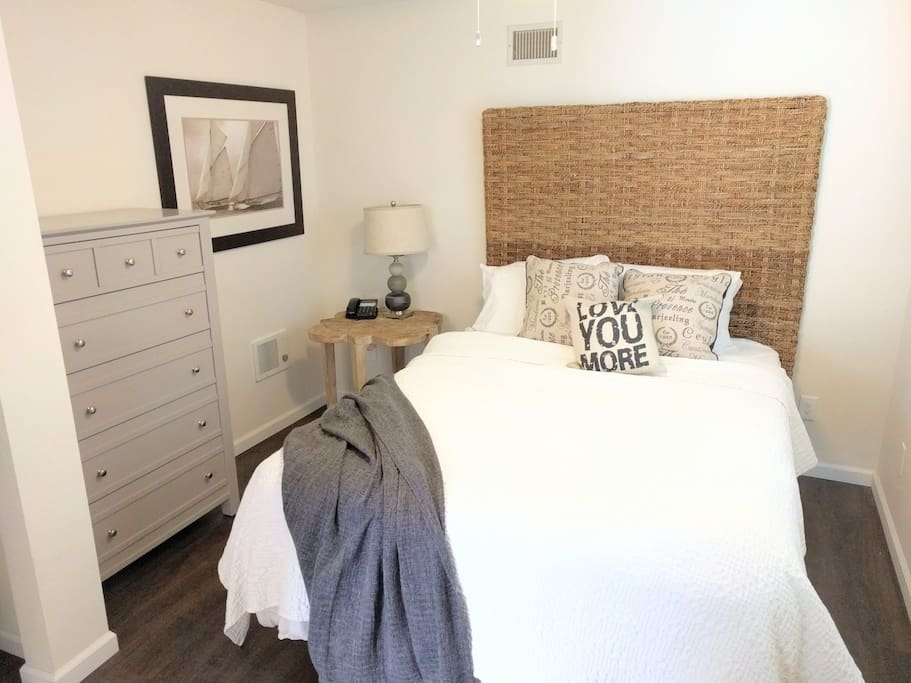 This bedroom has a full body mirror, closet with hangers, 5 drawer dresser, emergency phone, and reading lamp. There is a Pack n Play with a playpen, bassinet, and changing table attachment.