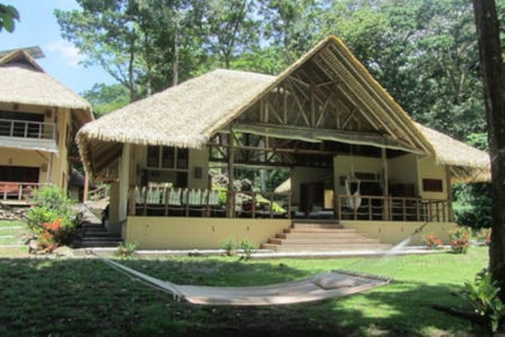 Front of the house and two cabins (on the two story building). Hammock in the front!