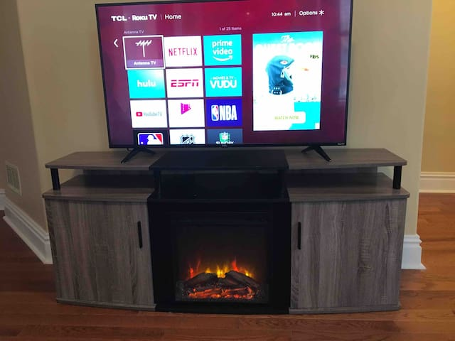 50 inch led tv with amazon prime and Netflix. Also heated electric fireplace.