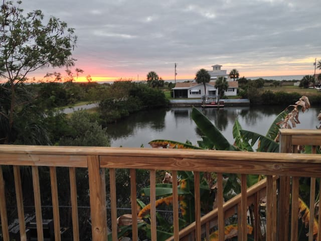 Rooftop sunset deck faces due West and has a 180 degree panoramic view of the Gulf of Mexico and surrounding wetlands.