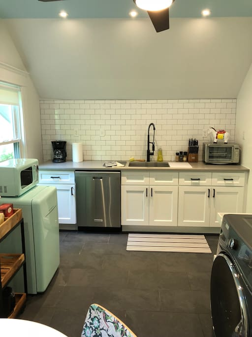 Brand new quartz counter top, cabinets, sink and appliances. This kitchen comes fully equipped with brand new dishwasher, washer and dryer, fridge, microwave, counter top convection oven, and induction stove top. Everything you need to whip up breakfast or heat up left overs ;)