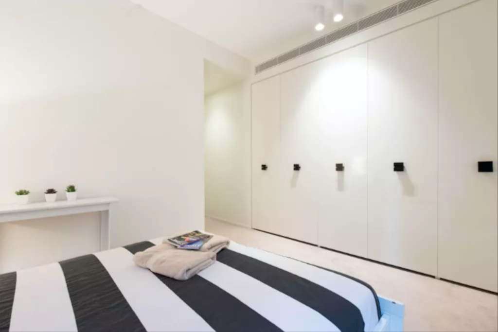 Your spacious room with glass window, BIR wardrobes, and an ensuite bathroom