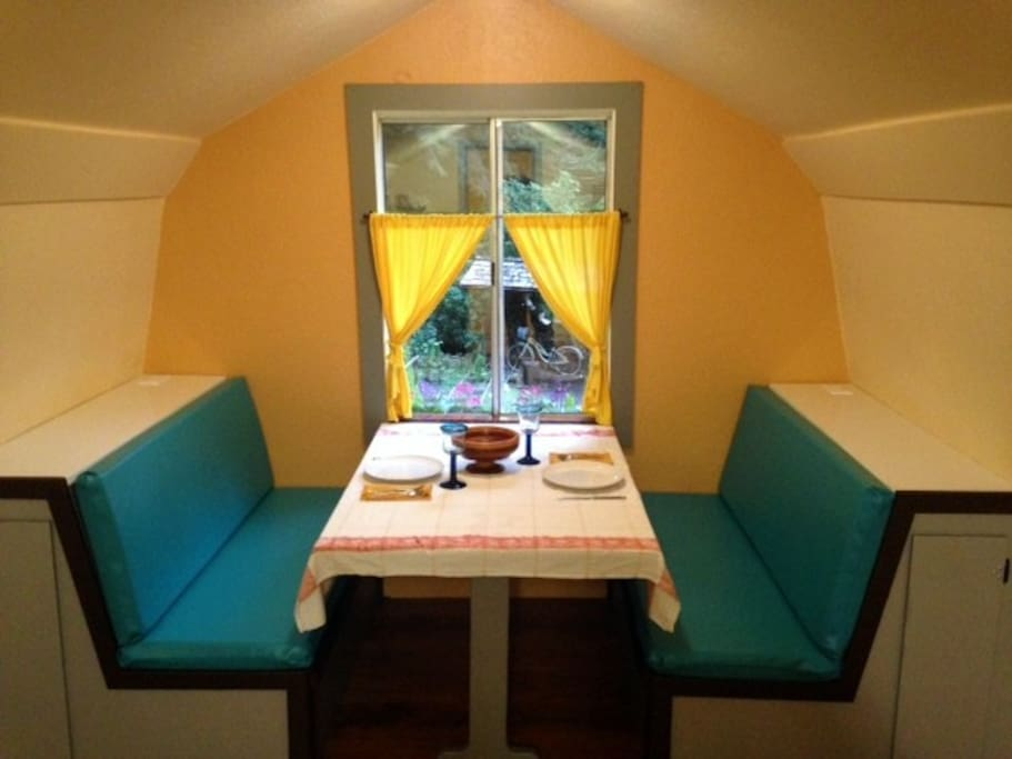 The built-in booth overlooks the yard, gardens and surrounding redwoods
