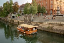 Must do on your Ljubljana bucket list is a ride with Ljubljanica boat! Have a nice sit with a glass of vine and just enjoy the views