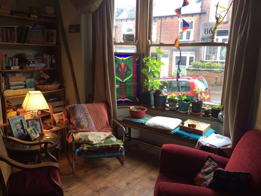 Sunny, street facing sitting room. Our furniture is an ever changing cycle of season and comfort .