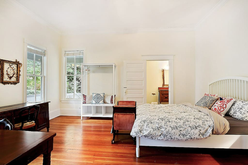 Large bedroom with original 19th c heart pine floors and restored Victorian details