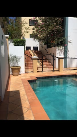 Appt has a relaxing pool and BBQ area