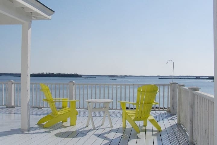 Sit and relax on the deck while enjoying the beautiful ocean view at Beechmont House
